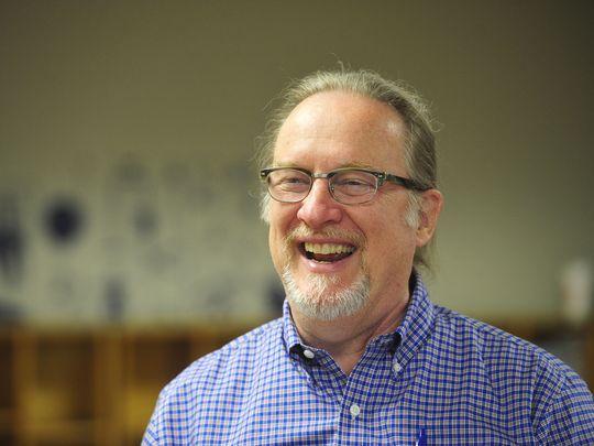Founder John Wark smiles in the lobby at Nashville