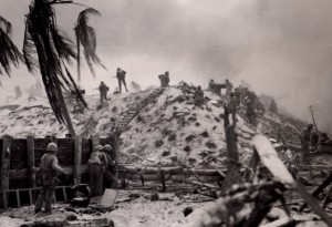 "Knoxville native Marine 1st Lt. Alexander ""Sandy"" Bonnyman, Jr., stands atop the bunker where he was killed during the battle of Tarawa on Nov. 22, 1943. Bonnyman, center at the top of the makeshift ladder, was awarded a Congressional Medal of Honor for his bravery. An effort is underway to find the remains of Bonnyman and other marines killed in the battle."